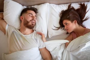WAYS TO STOP SNORING WHILE SLEEPING